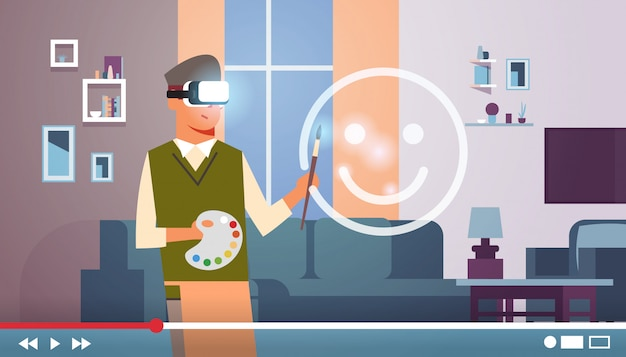 Man wearing vr glasses headset painter art blogger with paintbrush and palette drawing virtual reality emoji live streaming video blogging concept portrait horizontal