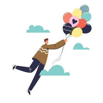 Man with balloons flying in sky