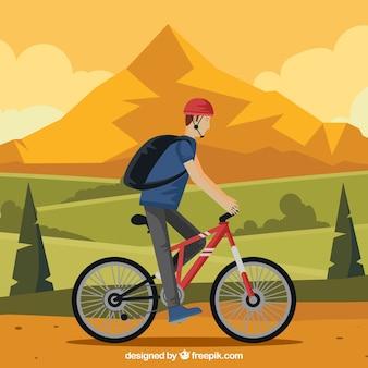 自然の中でバイクを持つ男