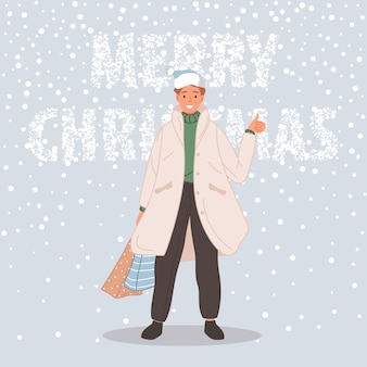 Man with christmas package male wearing in santa hat on snow background merry christmas concept