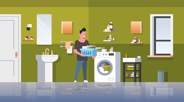 Man with clothes basket standing near washing machine guy doing housework laundry room modern bathroom interior male cartoon character