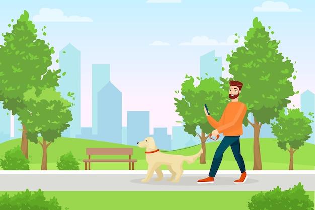 公園を歩いている犬と男