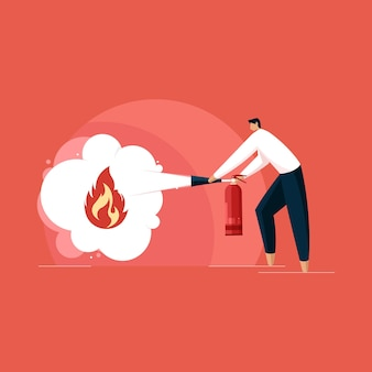 Man with fire extinguisher in hand with foam protection from fire flame firefighter with fire safety concept
