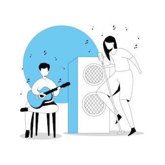 ギターと女性の歌手を持つ男