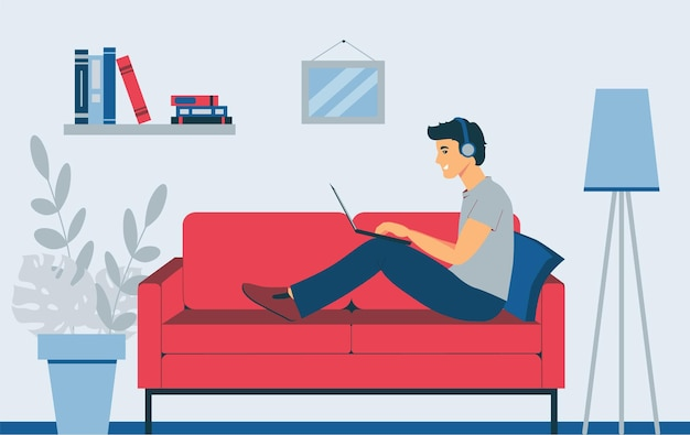 A man with a laptop sits on the sofa. freelancer listens to music. remote work.