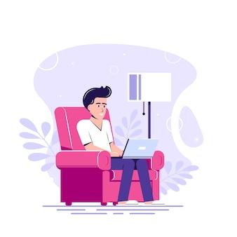 Человек с ноутбуком сидит в кресле и работает.