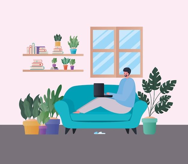 自宅のテーマから仕事の青いソファのデザインに取り組んでいるラップトップを持つ男