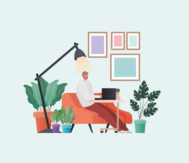 自宅のテーマからの仕事のオレンジ色のソファのデザインに取り組んでいるラップトップを持つ男