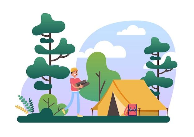 캠핑 텐트에 서있는 로그 더미를 가진 남자