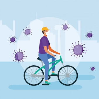自転車の医療マスクを持つ男