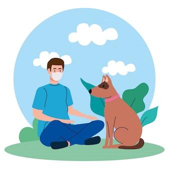 コロナウイルスcovid 19に対して、医療マスクを身に着けているペットの犬を持つ男