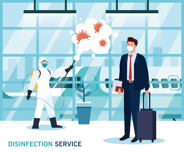 Man with protective suit spraying airport hall with
