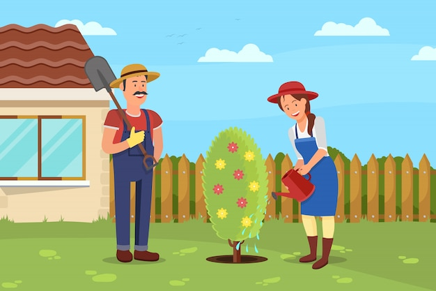 Man with shovel and woman watering plant
