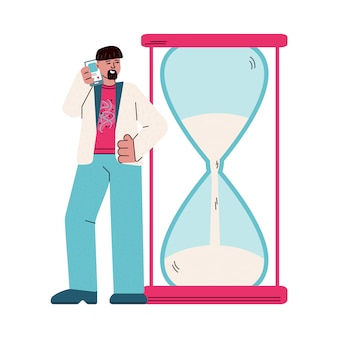 Man with smartphone looking at time left on giant hourglass