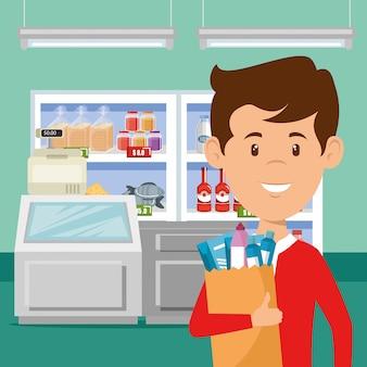 쇼핑백에 슈퍼마켓 식료품을 가진 남자