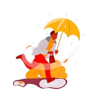 雨の下で急いで傘を持った男風の強い秋の天気