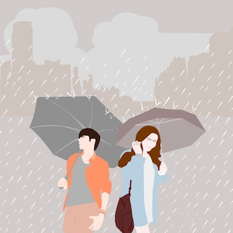 Man with umbrella and women with umbrella on rainy season in the city