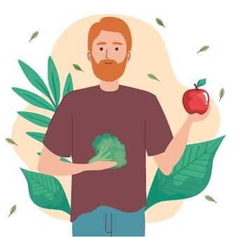 야채와 잎을 가진 남자