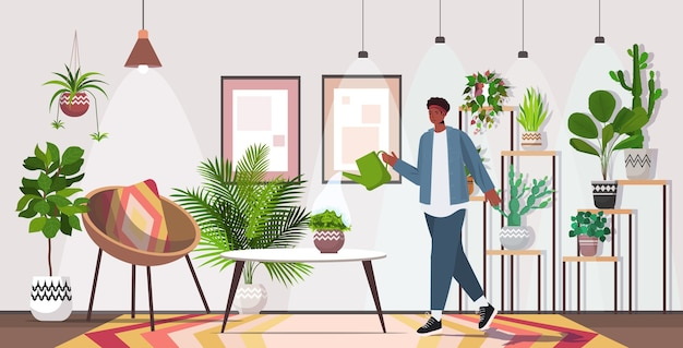 Человек с лейкой заботится о комнатных растениях гостиная или домашний сад интерьер горизонтальный