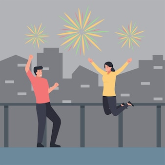 Man and woman celebrate and fireworks on the sky with building background