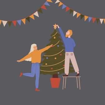 A man and a woman decorate a christmas tree. new year or christmas design.