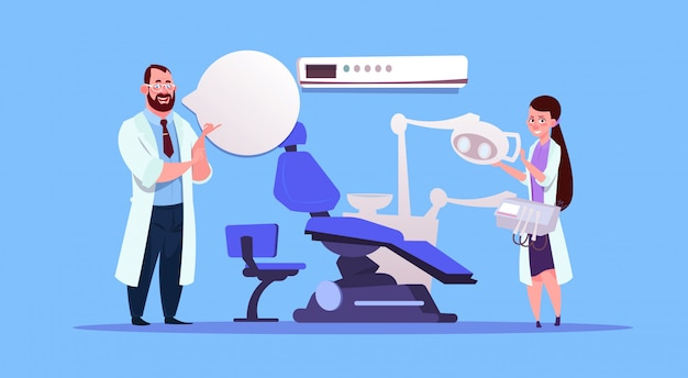 Man and woman doctors over dental office equipment dentist hospital