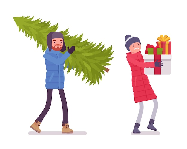 Man and woman in a down jacket with christmas tree and presents, wearing soft warm winter clothes, snow boots and hat