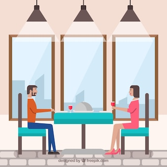 Man and woman having dinner with wine