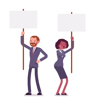 Man and woman holding picket signs, copy space