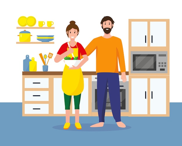 Man and woman in the kitchen are cooking. housewife and her husband at home.