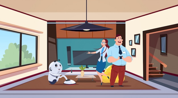 Man and woman looking at robot housekeeper cleaning living room