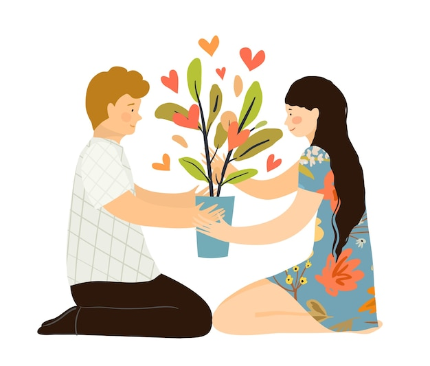 Man and woman in love sitting with houseplant on the floor, hunker down, holding flowerpot with bearing hearts plant. growing love together psychological concept.