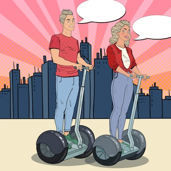 Man and woman riding segway in the city