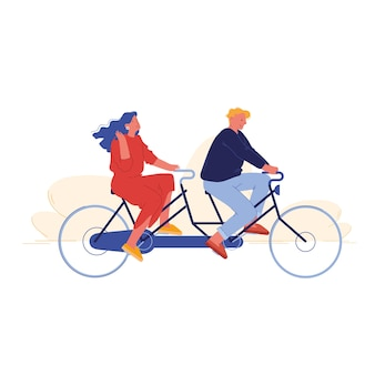 Man and woman riding tandem bike in public park