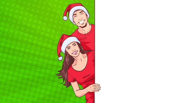 Man and woman in santa hats advertisement banner with template space for text over comic pop art bac
