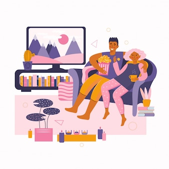 Man and a woman spend time together at home and watches movie on tv. home online movie theater. stay at home together.