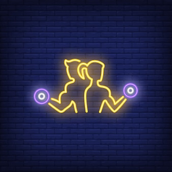 Man and woman training with dumbbells neon sign