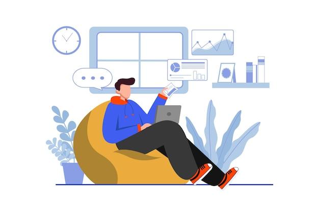 Человек работает из дома на диване со своим ноутбуком