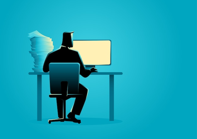 Man working behind desktop computer