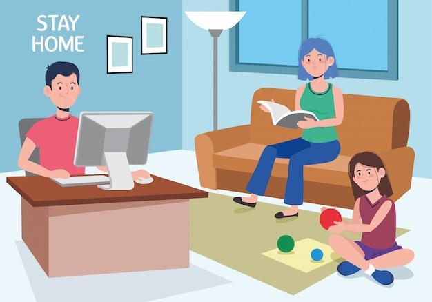 Человек, работающий в доме с компьютером и его семьей