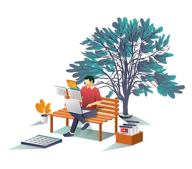 Человек, работающий с ноутбуком под деревом
