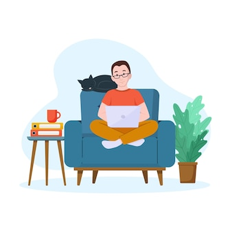 A man works on a laptop on an armchair work from home concept freelance