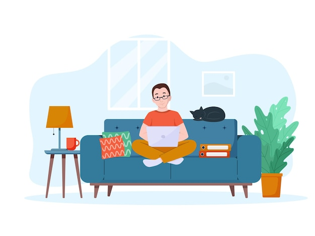 A man works on a laptop on the couch work from home concept freelance