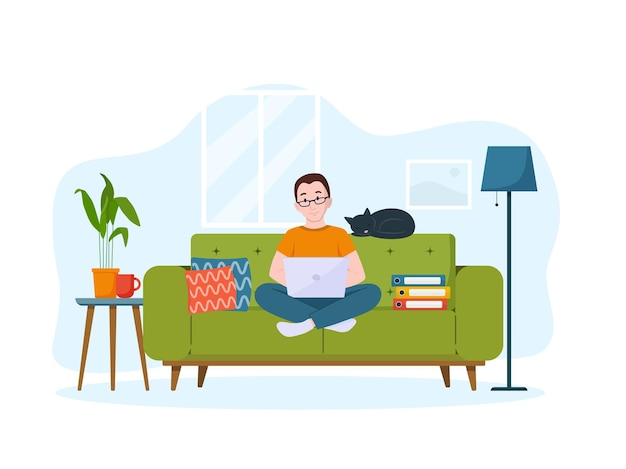 A man works on laptop on the couch work from home concept