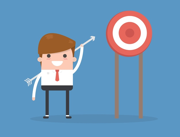 Manager or businessman throws arrows at a target.