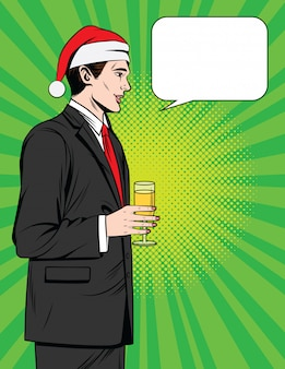 Manager standing in profile in suit in santa claus hat
