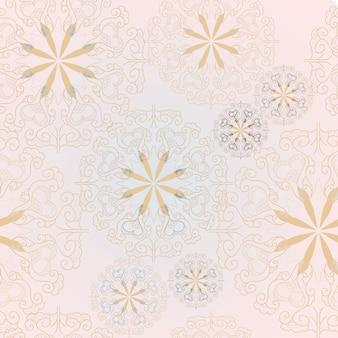 マンダラピンクと青の花のシームレスなパターン