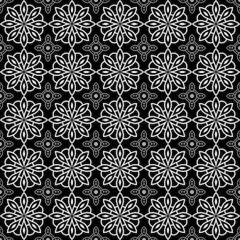 マンダラのシームレスなパターン背景。幾何学的形状の壁紙。黒と白の色の花観賞用