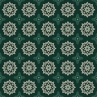 マンダラのシームレスなパターン背景。幾何学的形状の壁紙。緑のエメラルド色の花観賞用