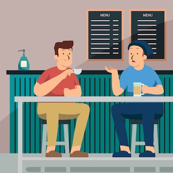 Mans are talking while enjoying their beverage at coffee shop